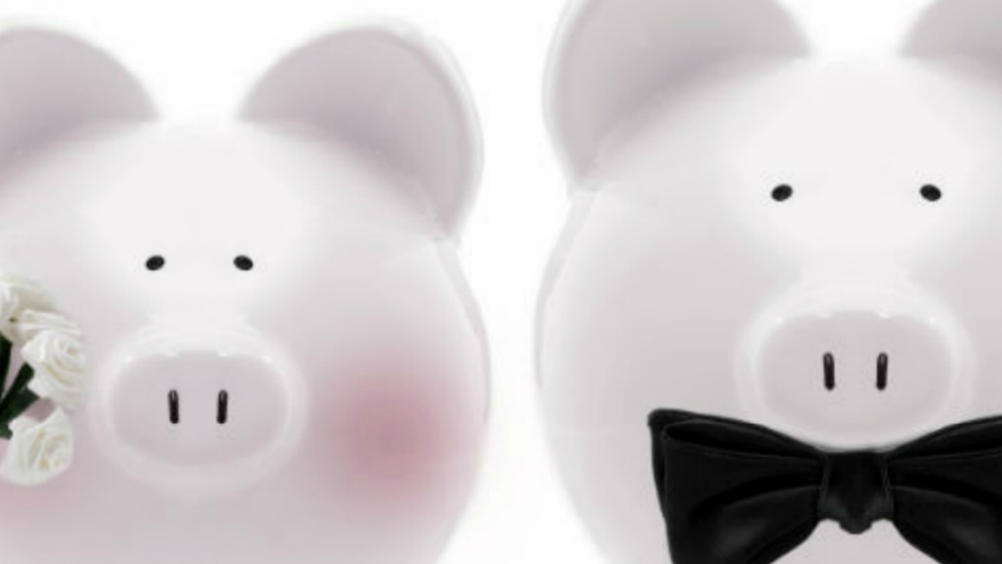 wedding piggy banks, blushing bride with flowers and groom wearing a black bow tie