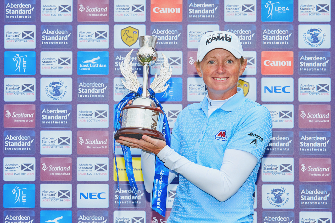 Stacy Lewis holding the winners trophy