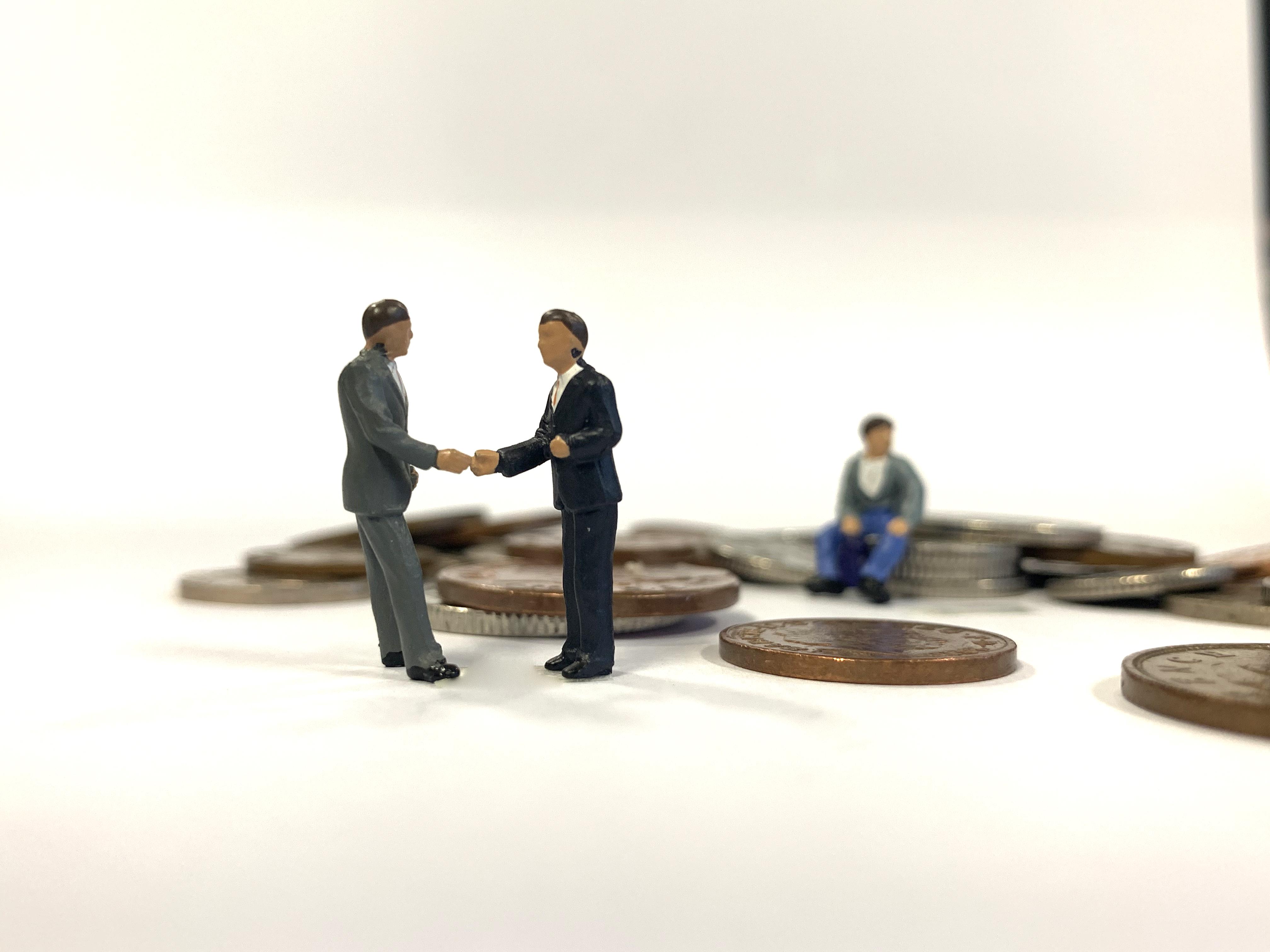 Handshake fallen coins