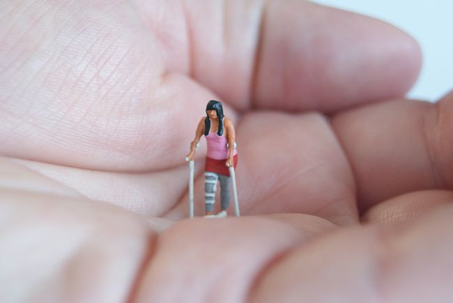 small model figure with crutches