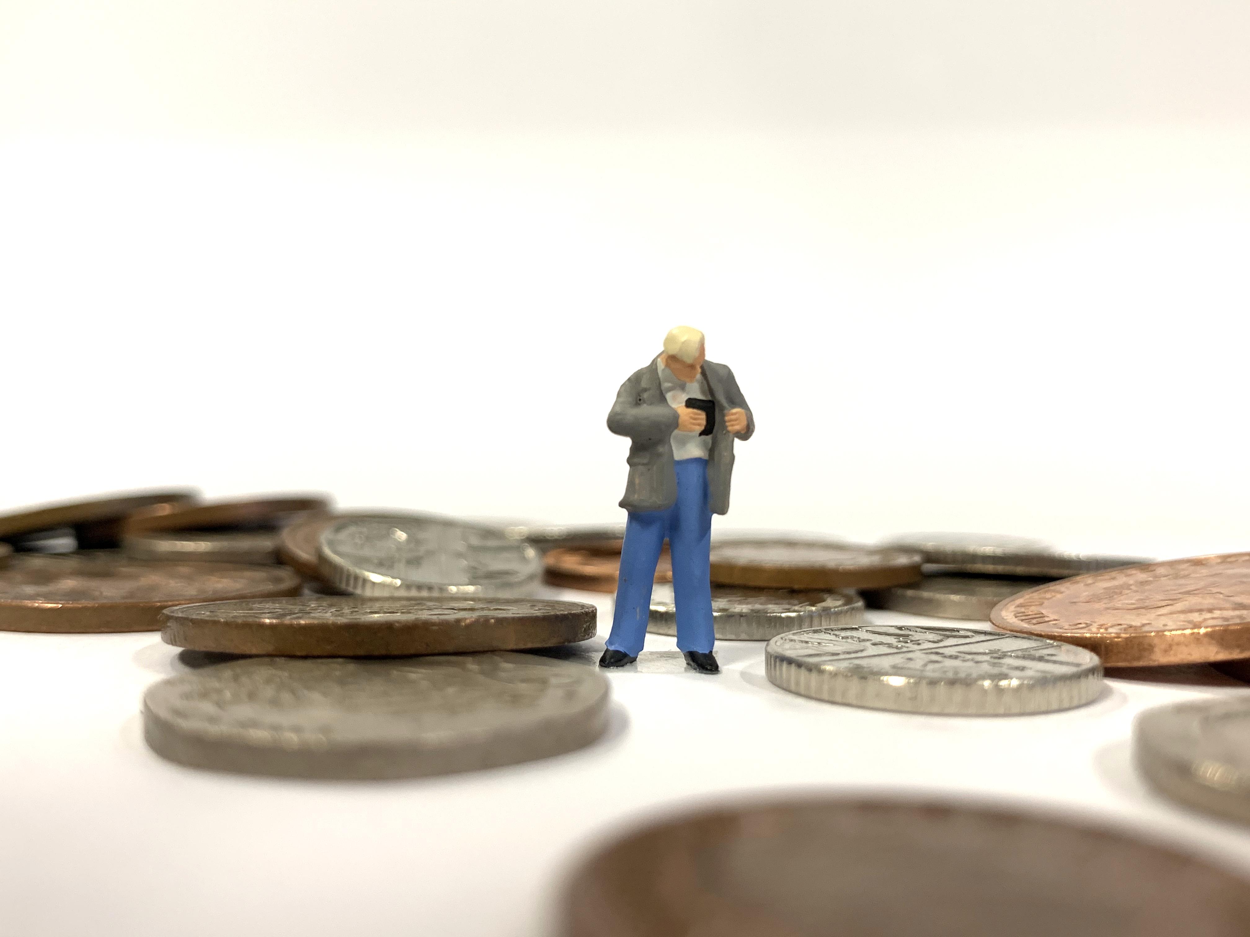 Small model figure looking in wallet