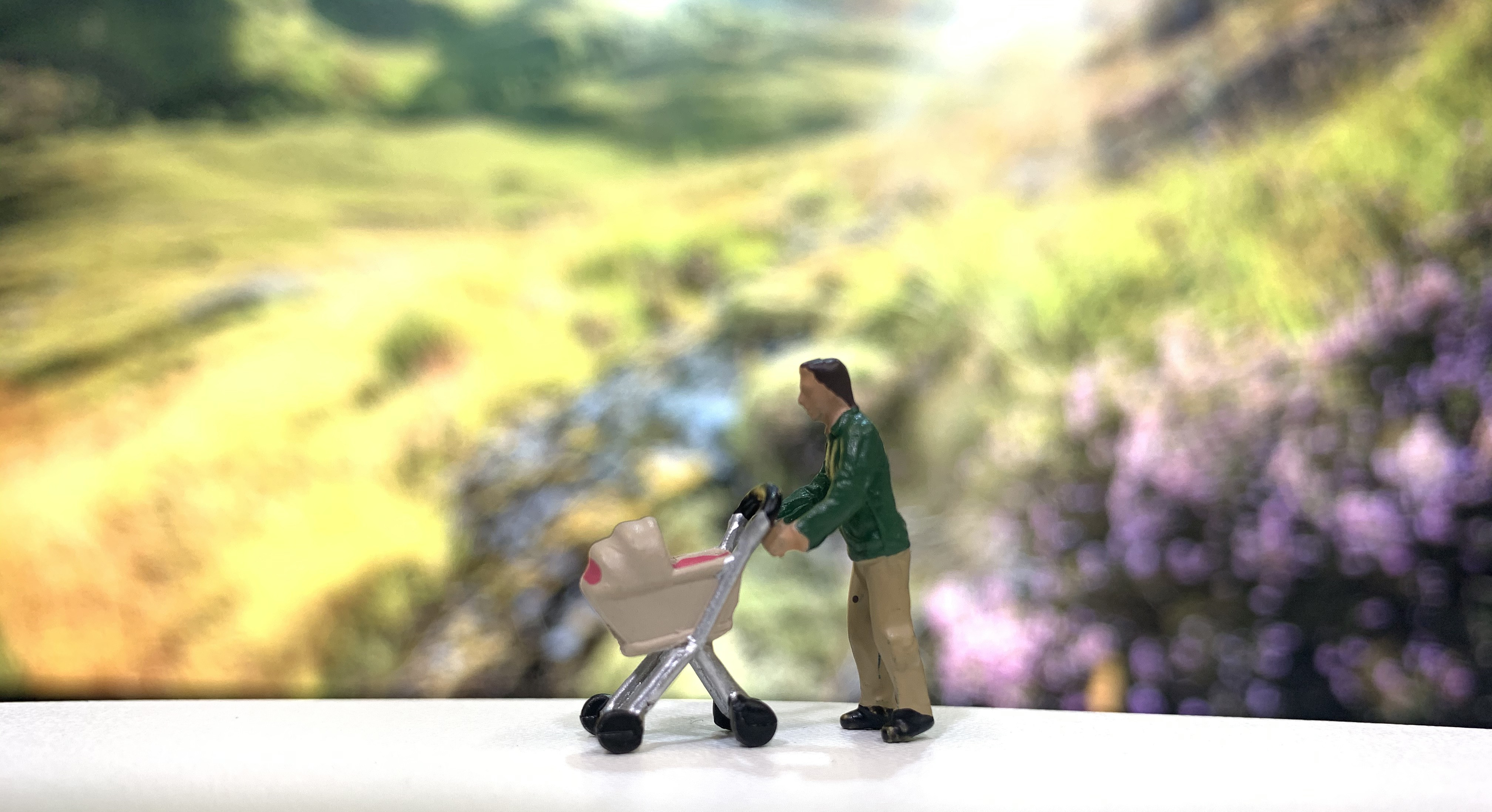 small model figure pushing a pram