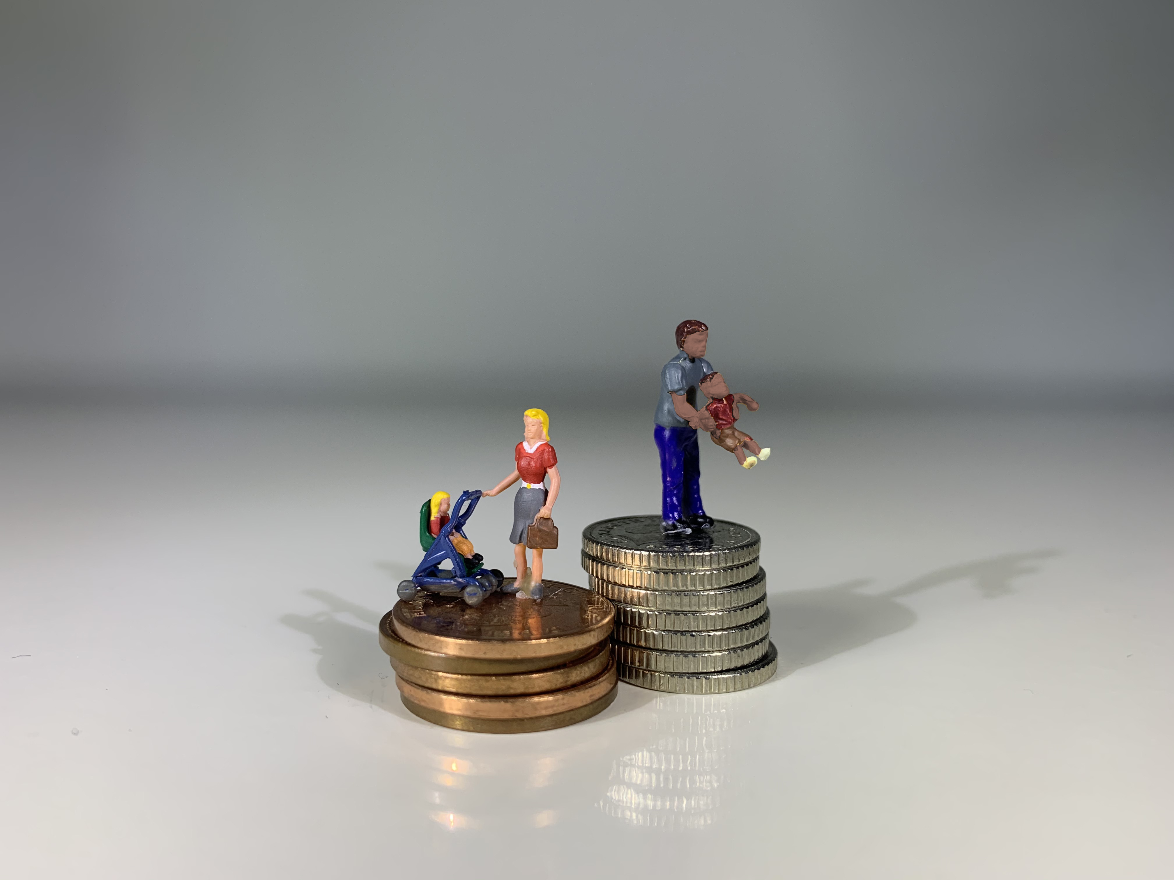 Family playing on top of coins