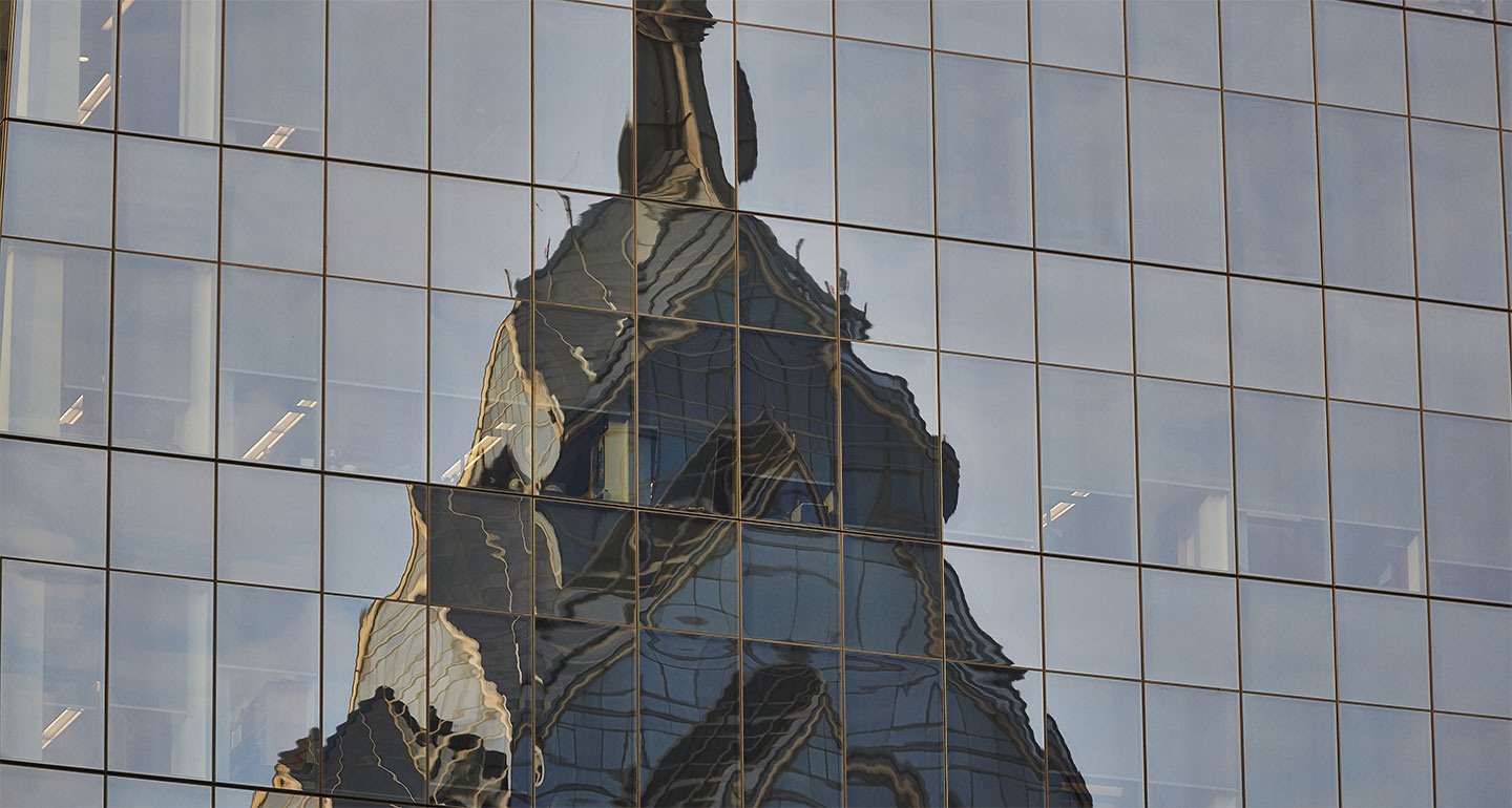 reflection of building on glass office wall