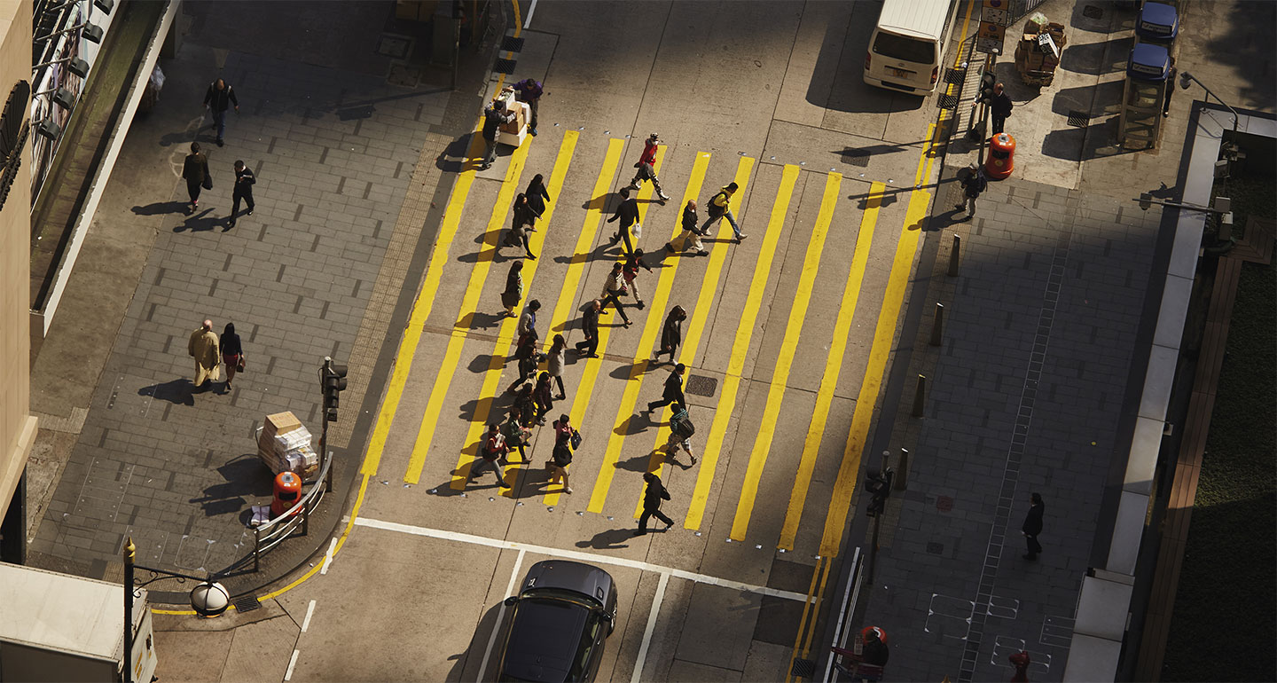 Busy street from above with people crossing