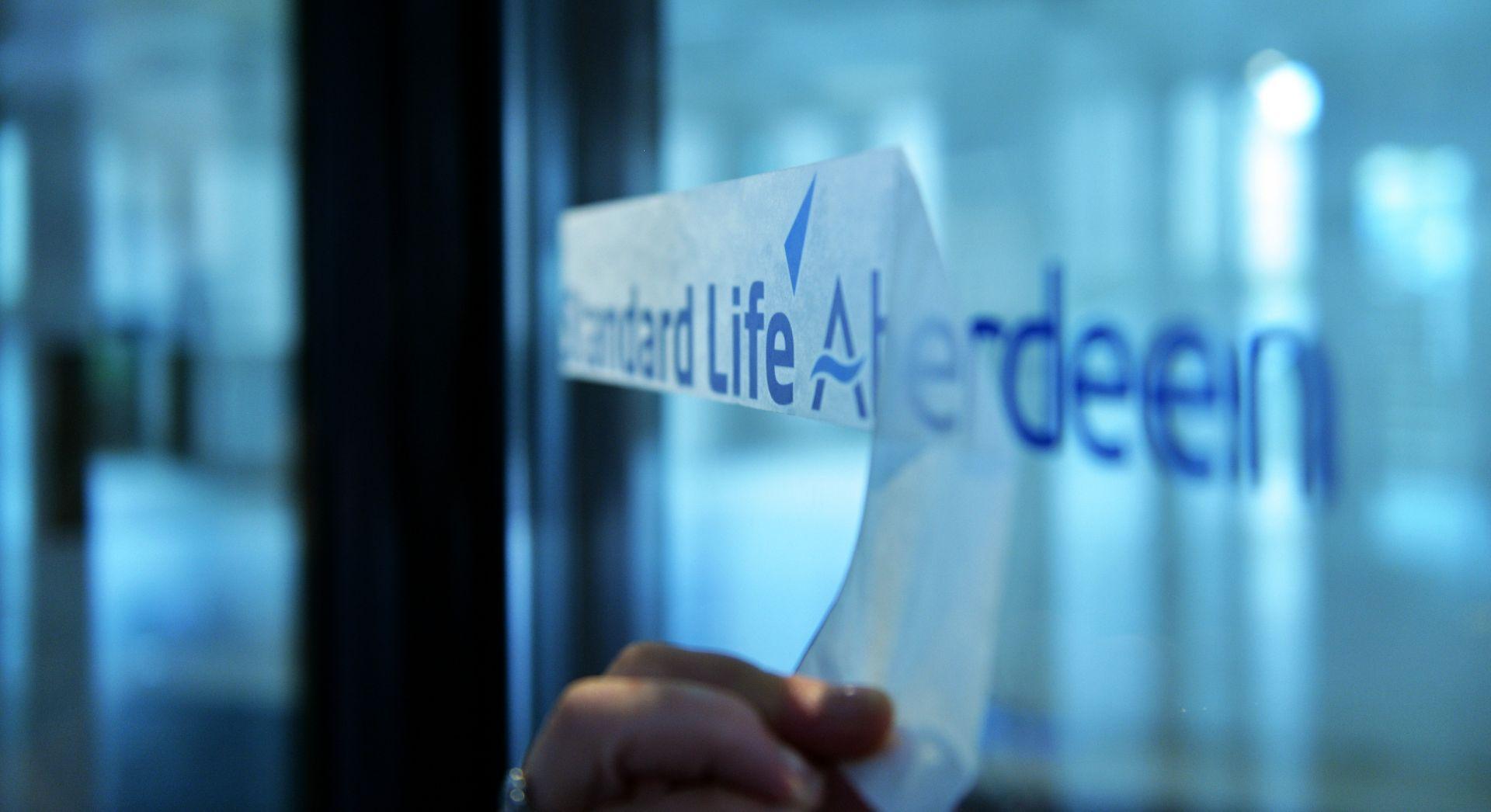 Standard Life Aberdeen logo on an office window