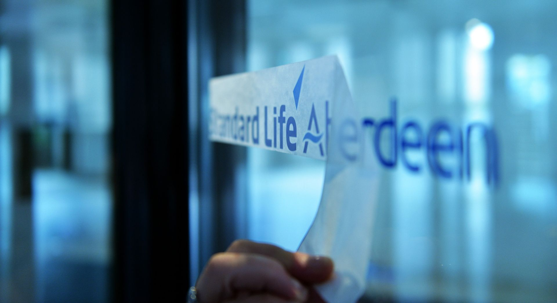 Standard Life Aberdeen logo on an office window