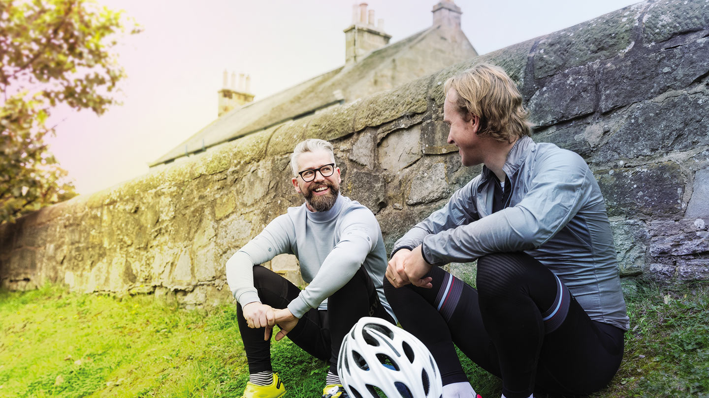 Two cyclists sitting