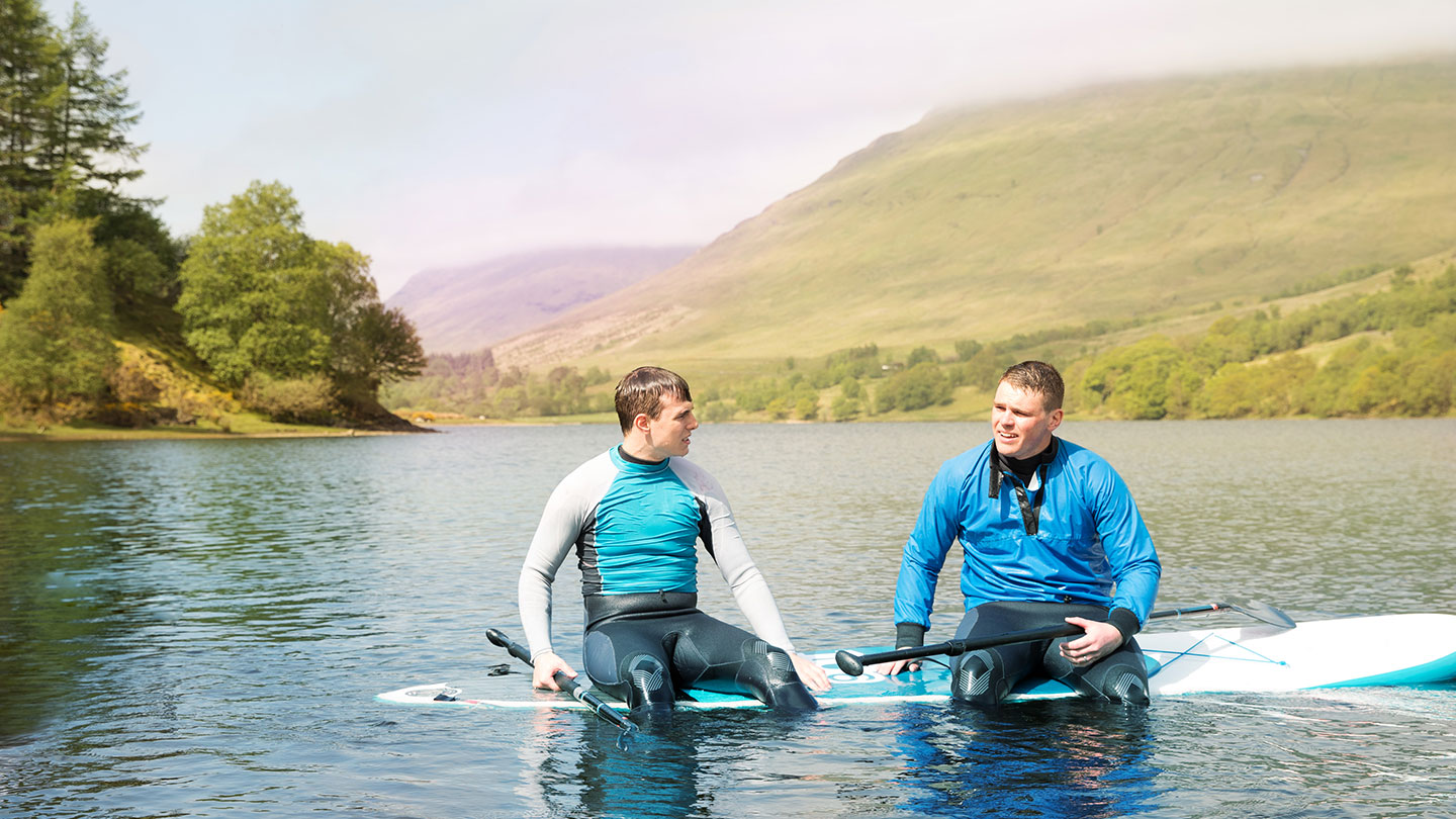 Two young men paddleboarding