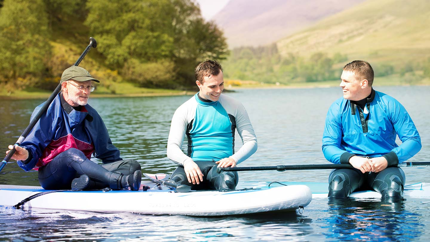 Three men paddleboarding