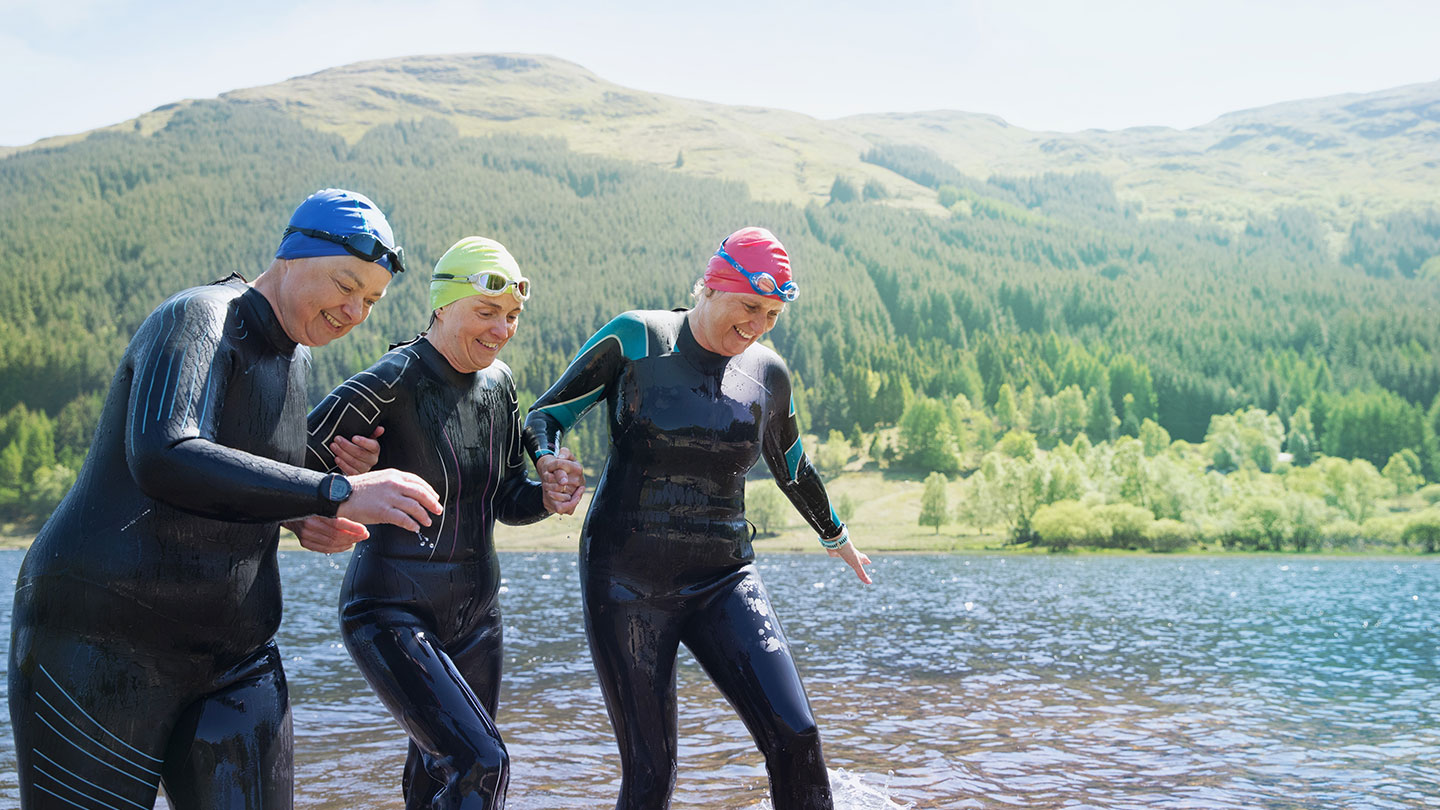 Three women emerging from a wild swim