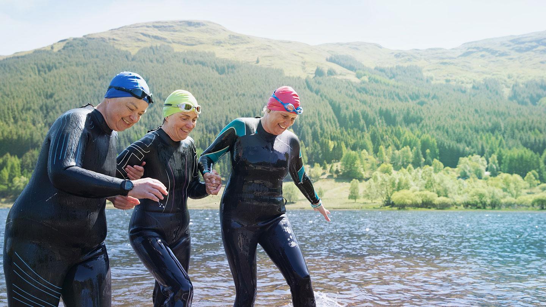 Three women emerging from a wild swim