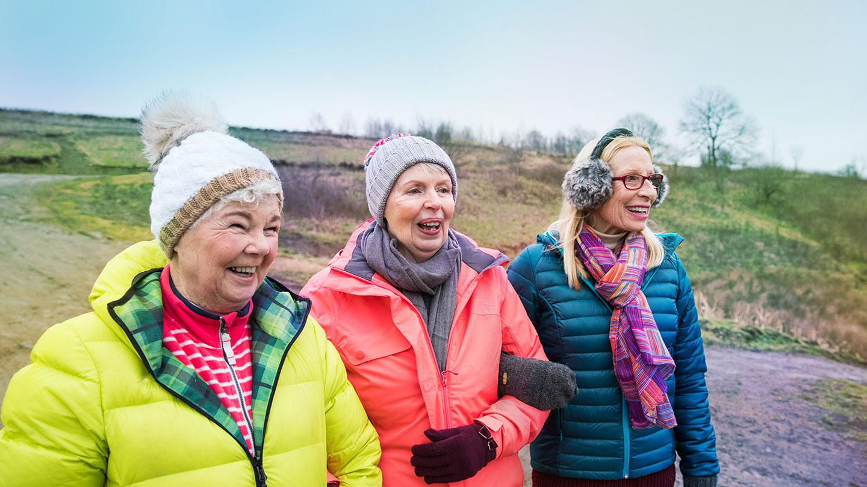 Three ladies on a hill