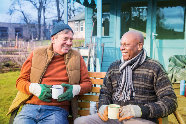 two men having a cup of tea in an allotment