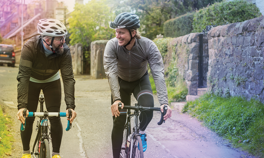 Two male cyclists in conversation