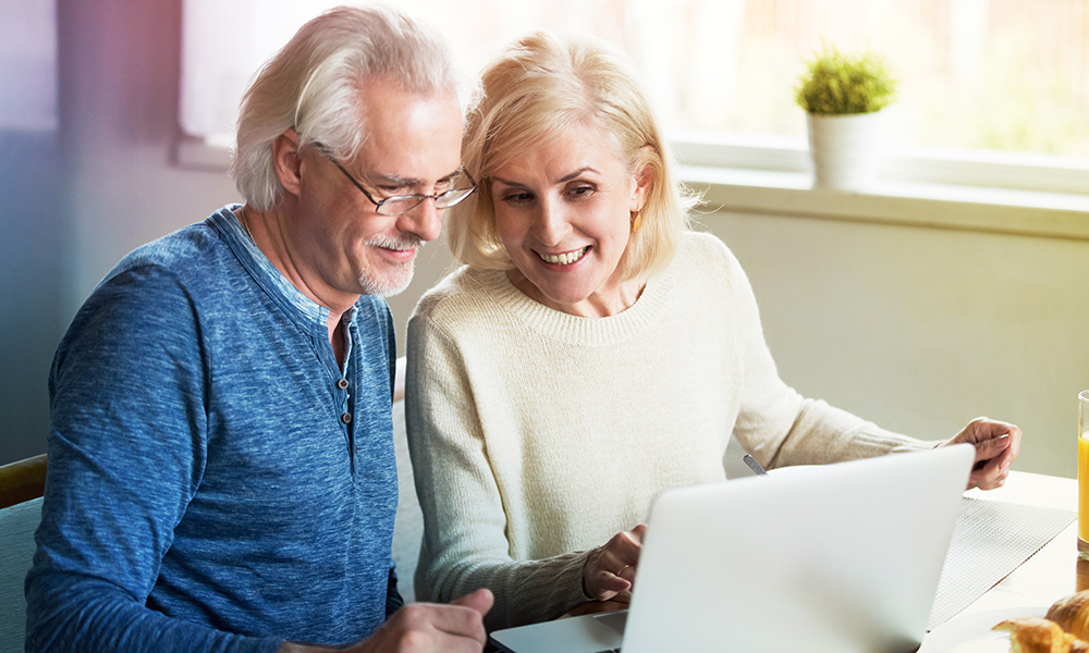 Mature couple looking at laptop in conversation