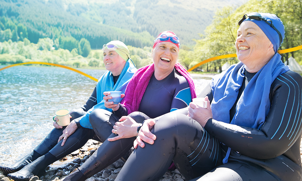 Three women chatting after swimming outdoors
