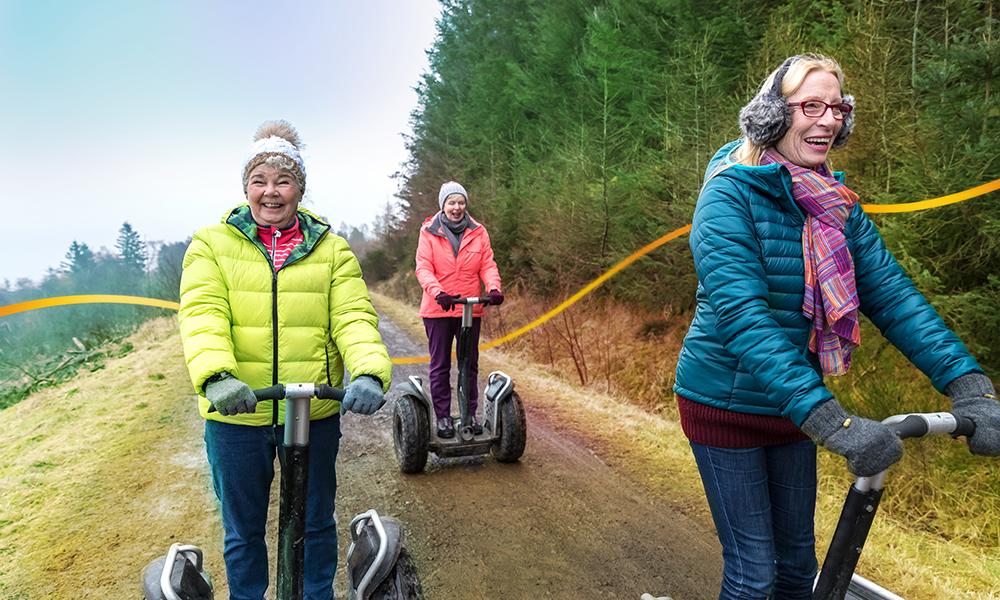 Three women having fun riding segways