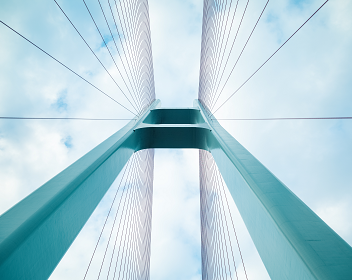 View of the sky from a modern suspension bridge