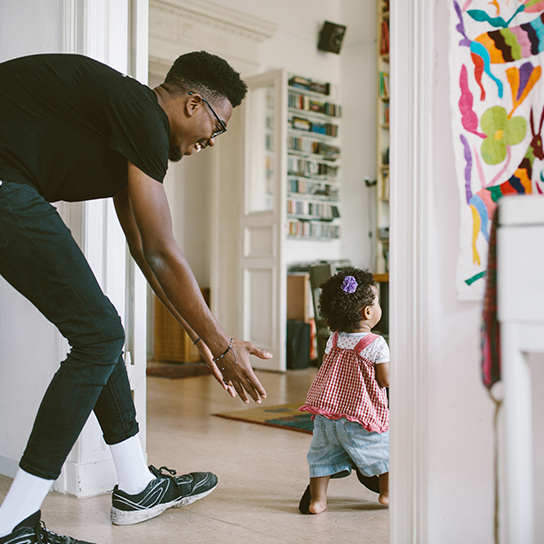 Dad and child playing