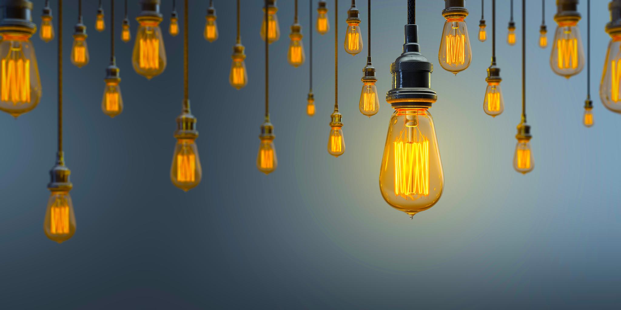 Hanging lit light bulbs