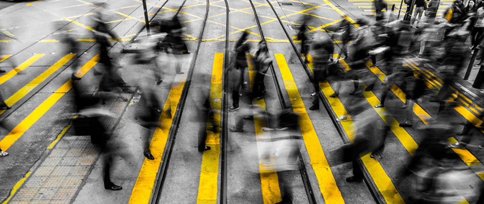Image of people crossing busy road